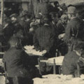 Photograph: People receive donations of milk and food courtesy of Dr. Charles A. Beard
