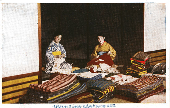 Postcard of volunteers collecting blankets and other relief materials for disaster sufferers