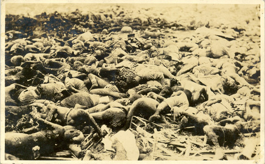 Postcard of dead bodies at the site of the Honjo Clothing Depot